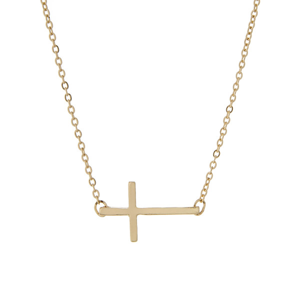 "Gold tone necklace with a 3/4"" horizontal cross pendant. Approximate 14"" in length."