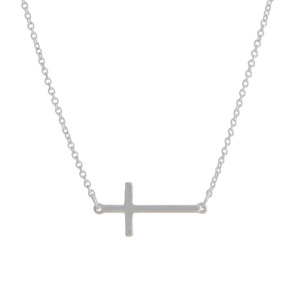 "Matte silver tone chain necklace with a 1"" horizontal cross pendant. Approximate 16"" in length."
