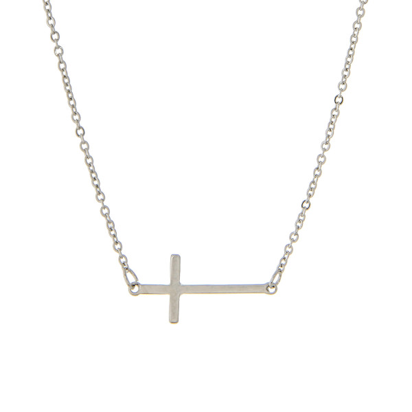 "Silver tone chain necklace with a small 1"" horizontal cross pendant. Approximate 16"" in length."