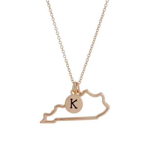 "Gold tone necklace with a cutout state of Kentucky pendant and a ""K"" charm. Approximately 18"" in length."