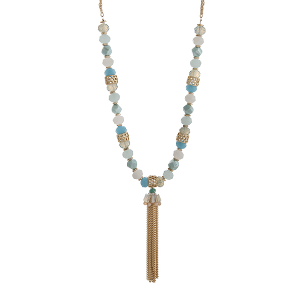 """Gold tone double strand necklace displaying blue and white beads with a chain tassel. Approximately 30"""" in length."""