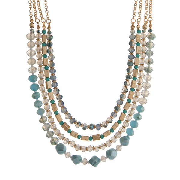 Wholesale gold layering necklace displaying strands turquoise blue glass beads