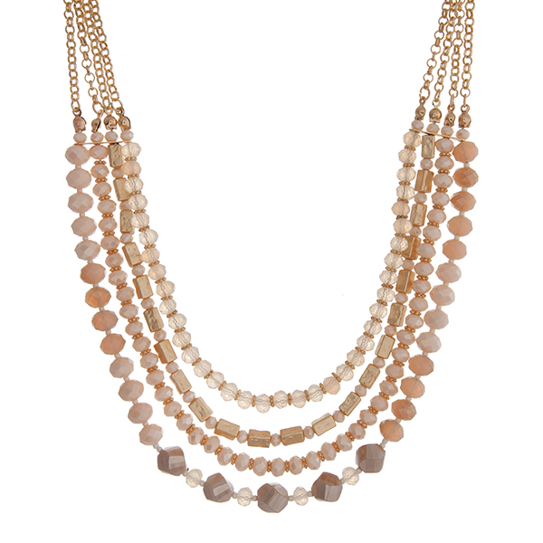 """Gold tone layering necklace displaying strands of ivory glass beads. Approximately 18"""" in length."""