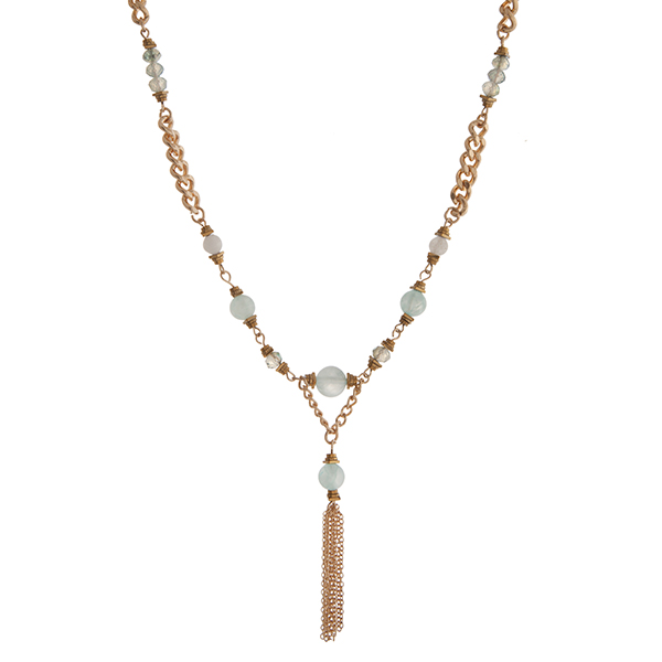 """Gold tone chain link necklace displaying mint green beads with a 1 1/2"""" chain tassel. Approximately 18"""" in length."""