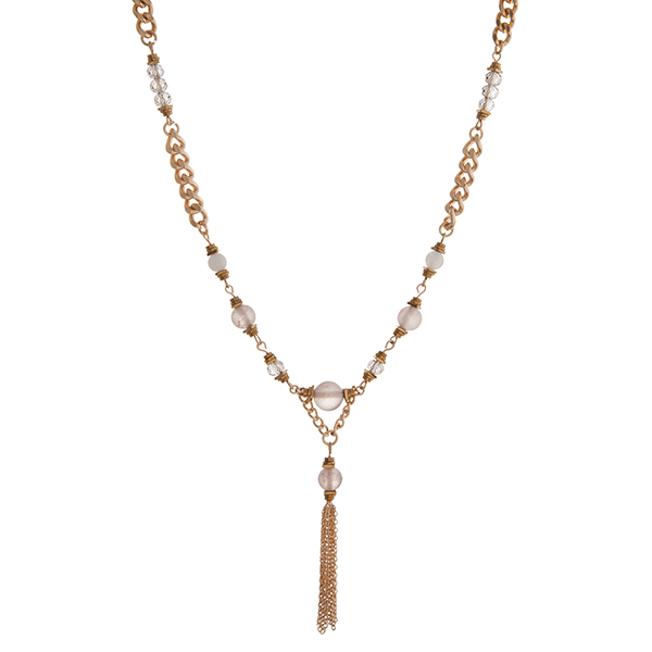 """Gold tone chain link necklace displaying gray beads with a 1 1/2"""" chain tassel. Approximately 18"""" in length."""