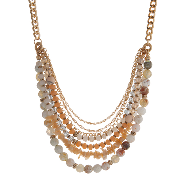"""Gold tone necklace displaying rows of ivory chipstone and peach and green beads. Approximately 18"""" in length."""