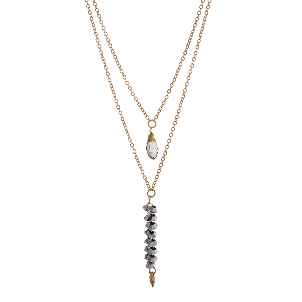 """Gold tone layering necklace displaying a wire wrapped gray teardrop shape stone and wire wrapped gray beads with a dangling spike. Approximately 17"""" in length."""