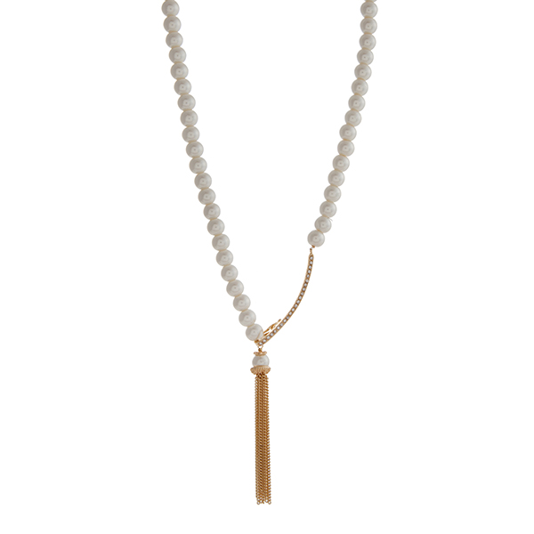 """Faux ivory pearl necklace displaying a gold tone pave bar with a latch and a chain tassel. Approximately 29"""" in length."""