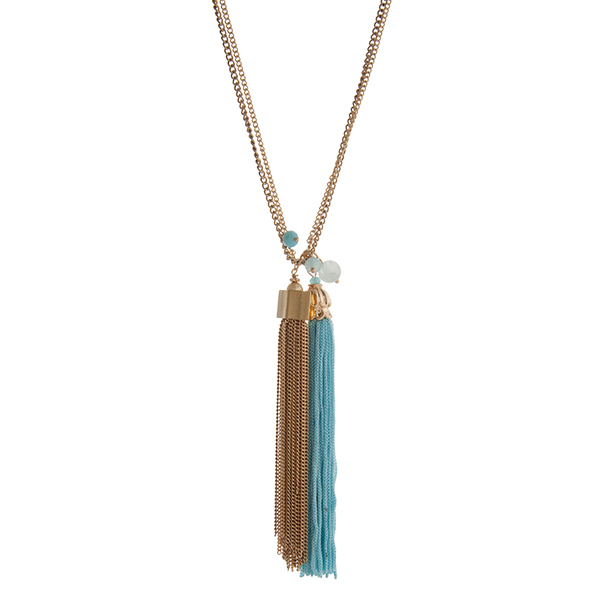 """Gold tone double strand necklace displaying a chain tassel and a blue fabric tassel. Approximately 32"""" in length."""