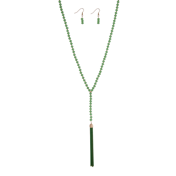 """Green beaded necklace set with a 3 1/4"""" chain tassel. Approximately 32"""" in length."""