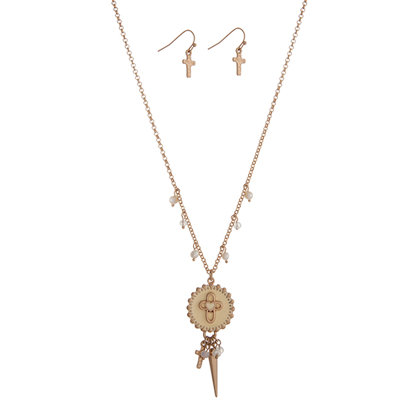 """Gold tone necklace set displaying a pale yellow cross disk with a cluster of beads, a cross charm, and a spike. Approximately 18"""" in length."""