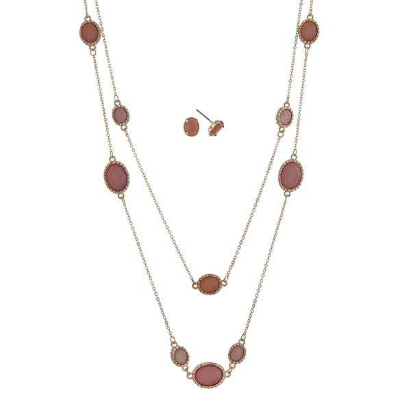 """Gold tone layering necklace set displaying pink oval cabochons. Approximately 30"""" in length."""