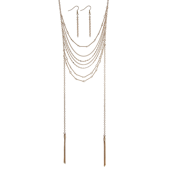 """Gold tone layering necklace set displaying draped of chains with two metal 2"""" tassels. Approximately 28"""" in length."""