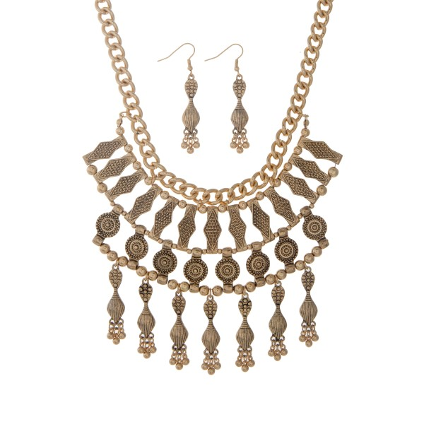 "Gold tone bohemian inspired necklace set with dangling charms. Approximately 19"" in length."