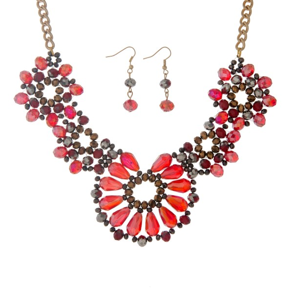 """Gold tone necklace set displaying a floral shape with red, gray, and brown glass beads. Approximately 15"""" in length."""