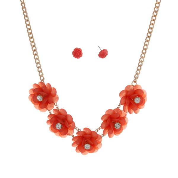 "Gold tone necklace set displaying five coral flowers with rhinestone accents. Approximately 17"" in length."