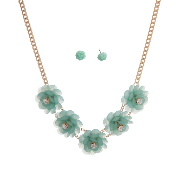 "Gold tone necklace set displaying five mint green flowers with rhinestone accents. Approximately 17"" in length."