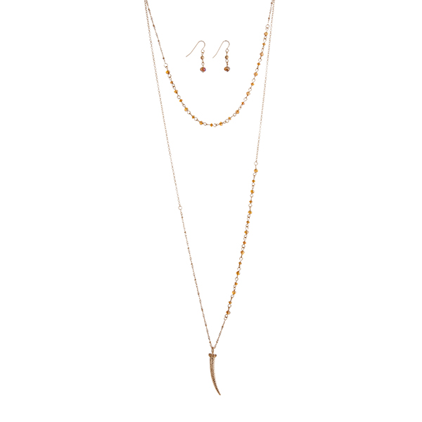 """Gold tone layering necklace set with topaz glass beads and a 1 3/4"""" horn pendant. Approximately 30"""" in length."""