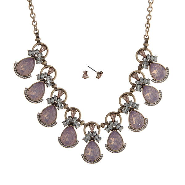 "Worn gold tone necklace set displaying pink opal teardrop shape cabochons surrounded by clear rhinestones. Approximately 16"" in length."