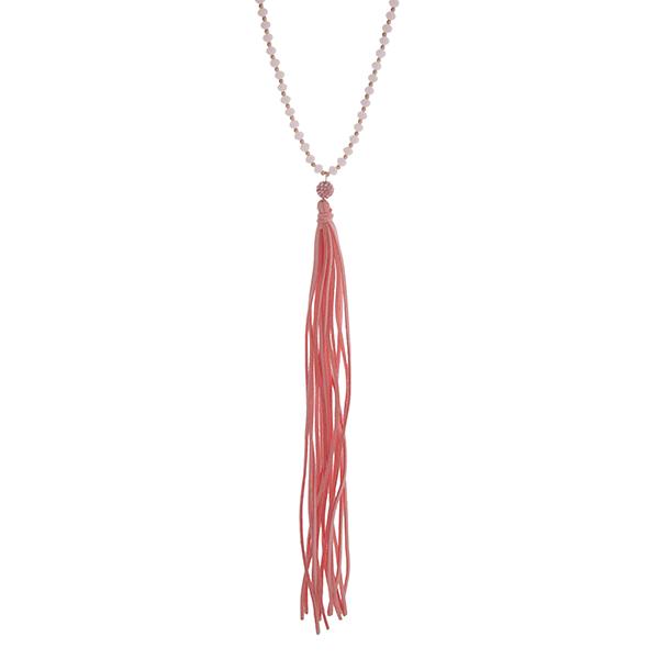 """Pink and gold tone beaded necklace with a long 9"""" suede tassel. Approximately 24"""" in length."""