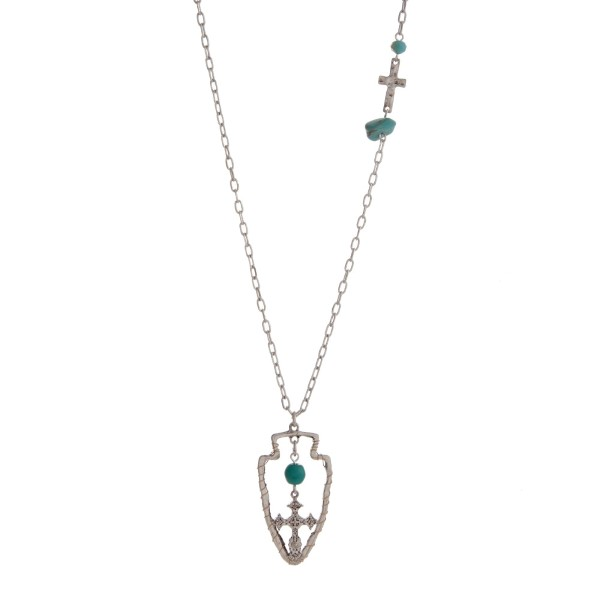 Wholesale burnished silver necklace displaying hammered cross station turquoise