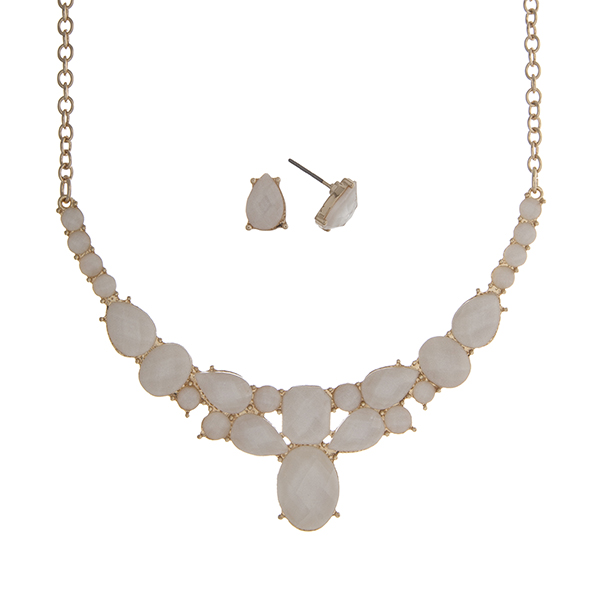 "Gold tone necklace set displaying multiple shape ivory cabochons. Approximately 16"" in length."