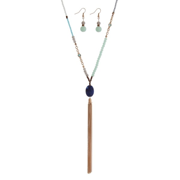 """Blue cord necklace set with mint green, gray and white beads and a chain tassel. Approximately 36"""" in length."""
