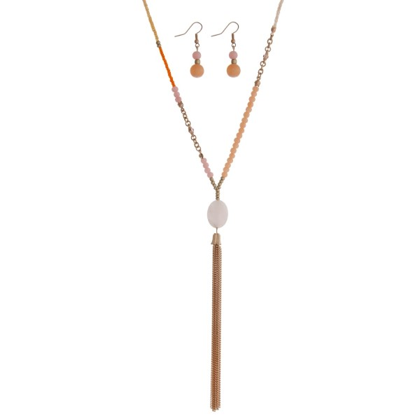 """Peach cord necklace set with peach, pink and orange beads and a chain tassel. Approximately 36"""" in length."""