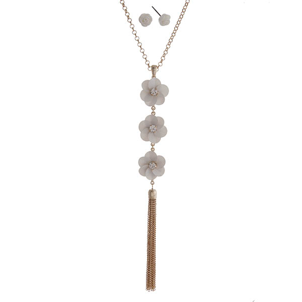 """Gold tone necklace set featuring white sequin flowers with clear rhinestone centers and a chain tassel pendant. Approximately 32"""" in length."""