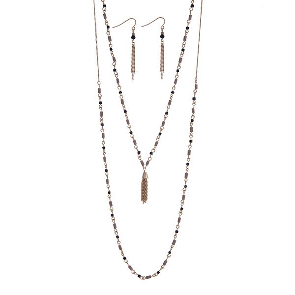 """Dainty gold tone double layer necklace set with gray and black beads accented with a chain tassel. Approximately 26"""" in length."""