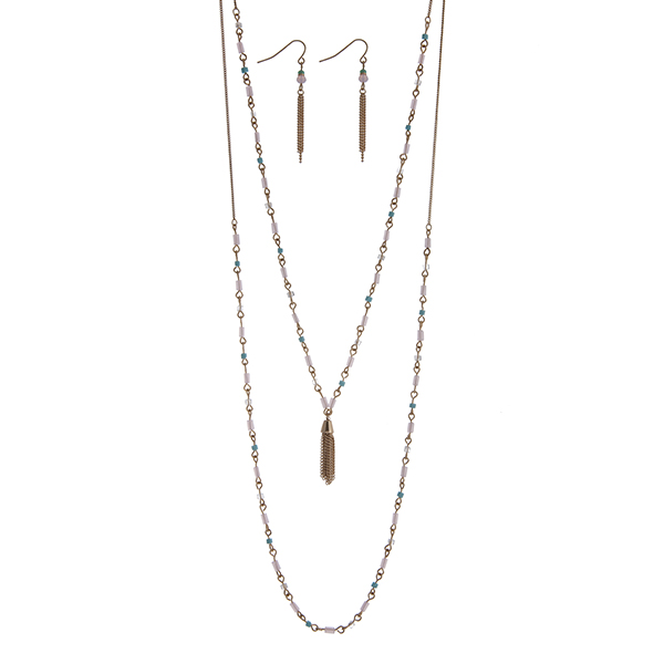"""Dainty gold tone double layer necklace set with light pink and blue beads accented with a chain tassel. Approximately 26"""" in length."""