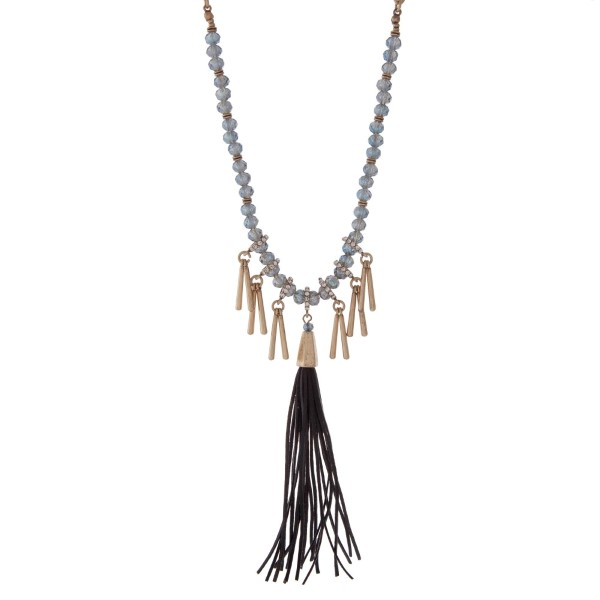 """Burnished gold tone necklace with navy blue beads featuring a gray tassel and accented with metal fringe. Approximately 32"""" in length."""