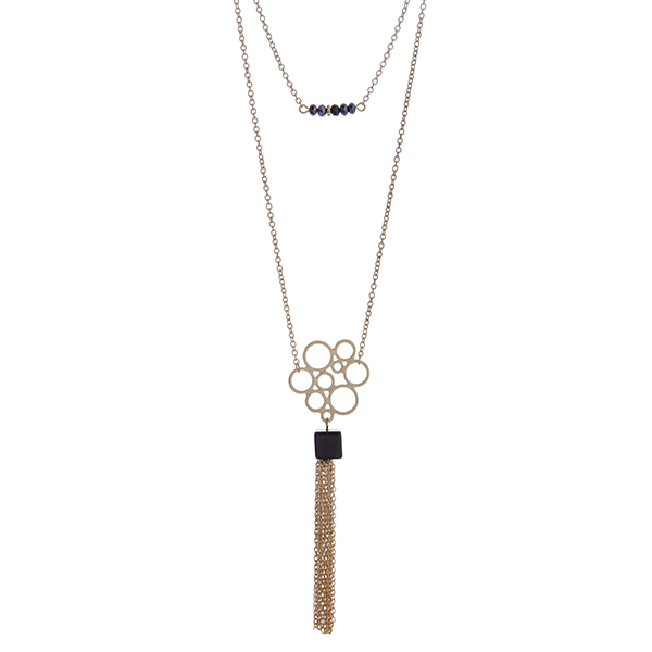 """Dainty gold tone double layer necklace with black beads and a natural stone pendant with a chain tassel. Approximately 36"""" in length."""