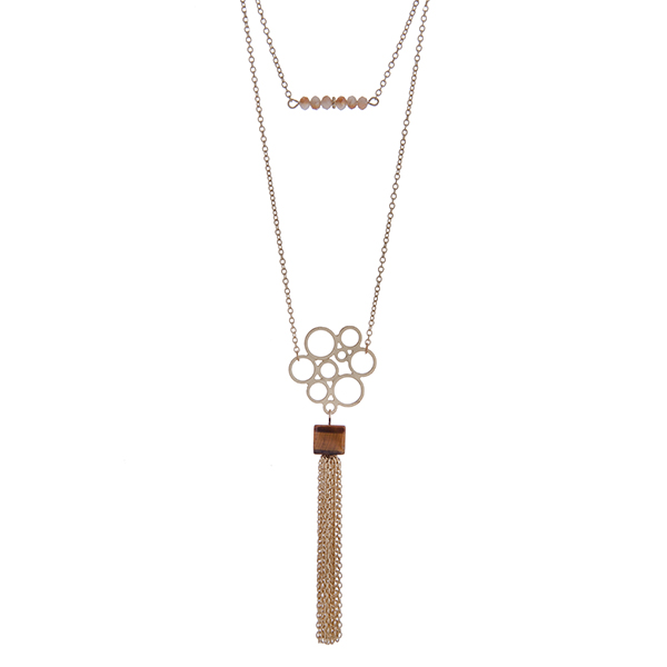 """Dainty gold tone double layer necklace with brown beads and a natural stone pendant with a chain tassel. Approximately 36"""" in length."""