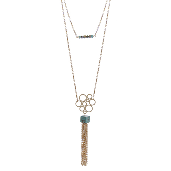 """Dainty gold tone double layer necklace with turquoise beads and a natural stone pendant with a chain tassel. Approximately 36"""" in length."""