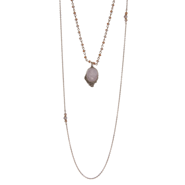 """Gold tone double layer necklace with a rose quartz natural stone pendant accented with pink beads. Approximately 32"""" in length."""