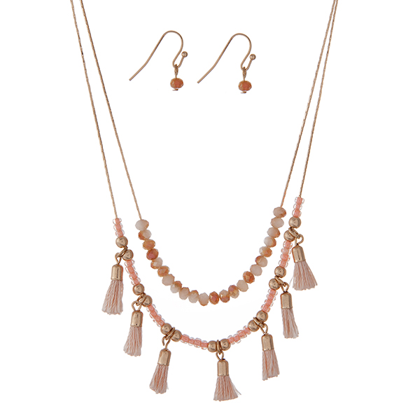 """Dainty gold tone double layer necklace set with peach beads and small blue tassels. Approximately 18"""" in length."""