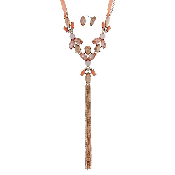 """Gold tone necklace set with peach rhinestones, a ribbon tie, and a chain tassel. Approximately 36"""" in length."""
