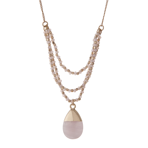"""Gold tone necklace with pale pink beads and a rose quartz natural stone pendant. Approximately 30"""" in length."""