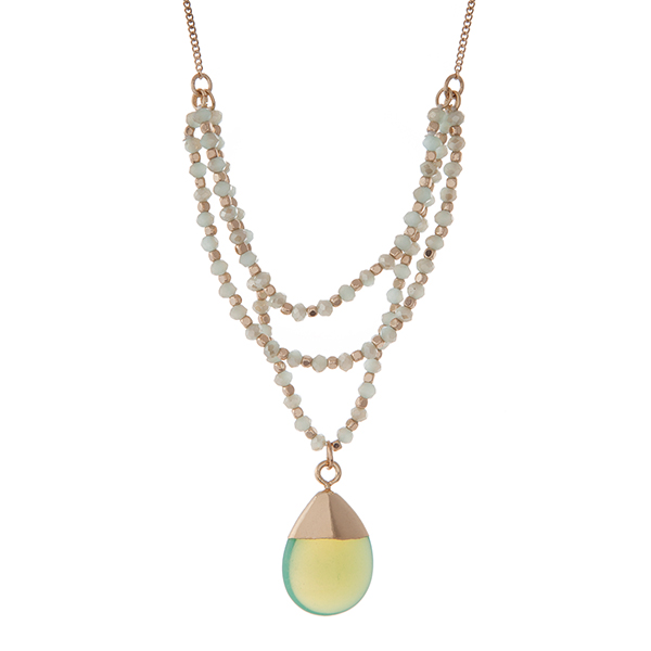 """Gold tone necklace with mint green beads and a  natural stone pendant. Approximately 30"""" in length."""