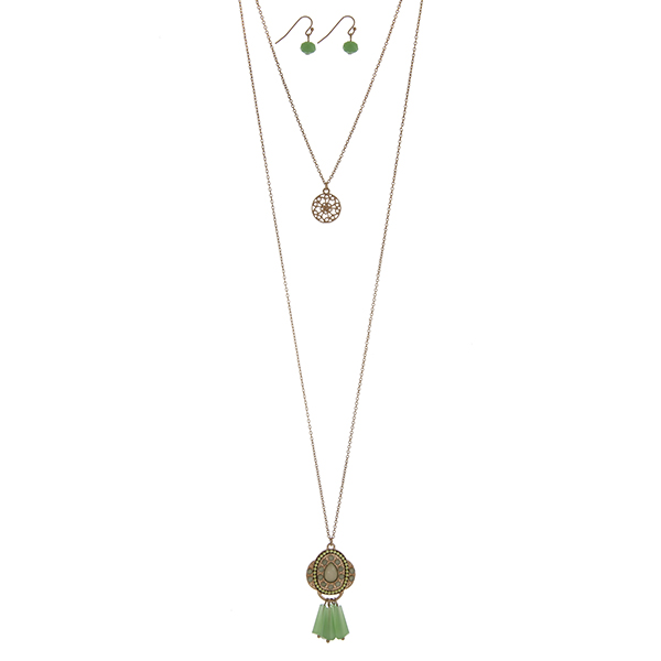 """Gold tone double layer necklace set with a filigree circle pendant and a mint green beaded Marrakesh pendant. Approximately 34"""" in length."""
