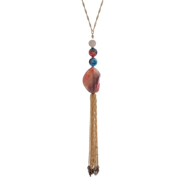 """Gold tone necklace with blue and pink natural stones and a chain tassel. Approximately 32"""" in length."""