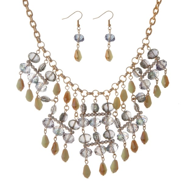 """Gold tone statement necklace set with mint green faceted glass beads and matching fishhook earrings. Approximately 18"""" in length."""
