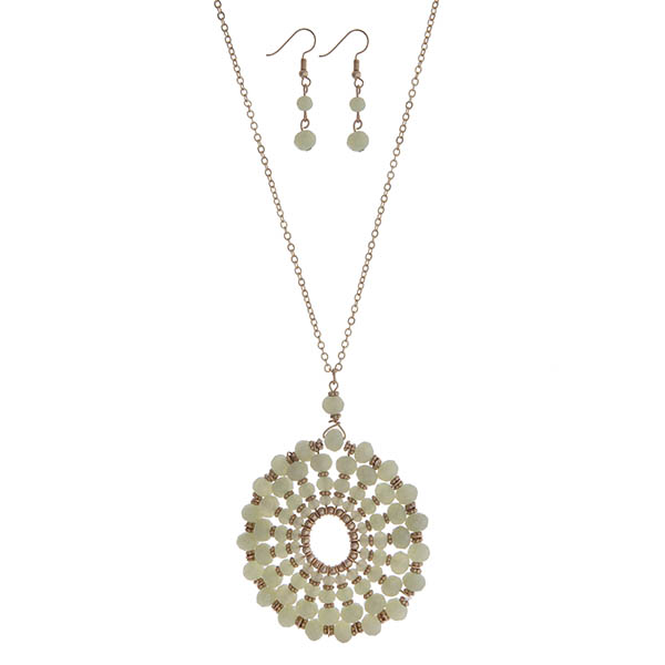 """Gold tone necklace set with a mint green beaded circle pendant. Approximately 32"""" in length."""