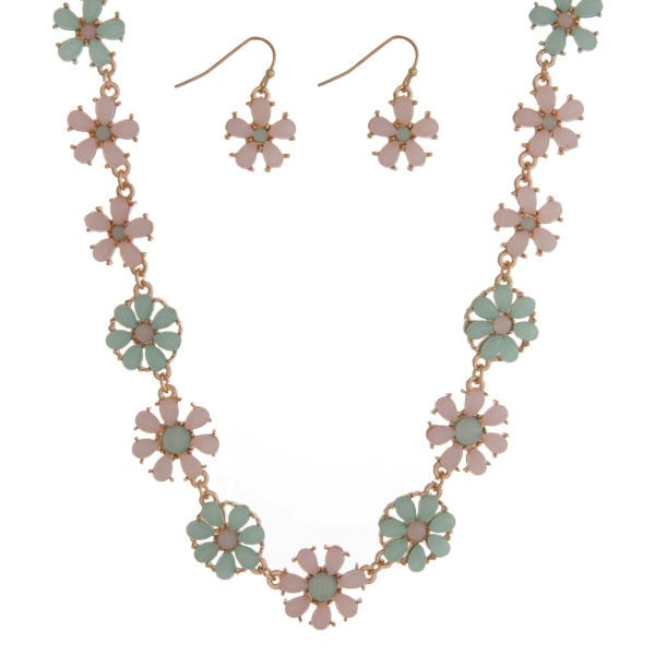 """Gold tone necklace seat featuring mint green and pale pink flowers with matching earrings. Approximately 16"""" in length."""