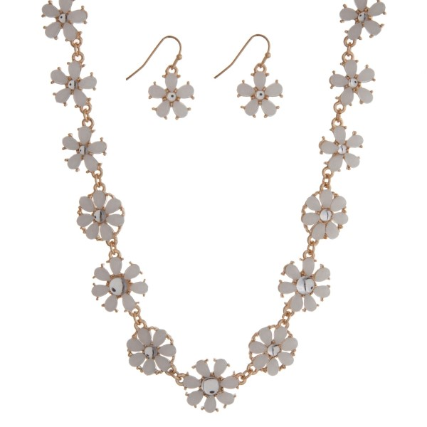 """Gold tone necklace seat featuring white flowers with matching earrings. Approximately 16"""" in length."""