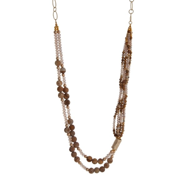 """Gold tone statement necklace featuring picture jasper natural stone beads accented with champagne faceted beads. Approximately 32"""" in length."""