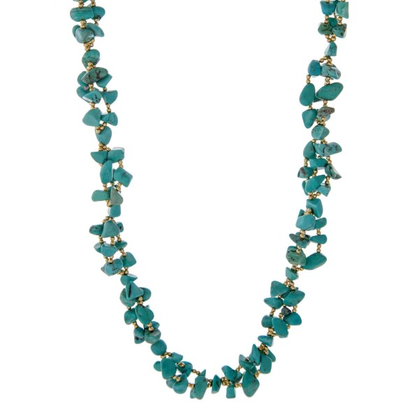 "Gold tone necklace featuring turquoise natural chip stones. Approximately 30"" in length. Handmade in the USA."