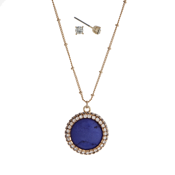 """Gold tone necklace set with a navy blue circle pendant accented with pave stones. Approximately 18"""" in length."""
