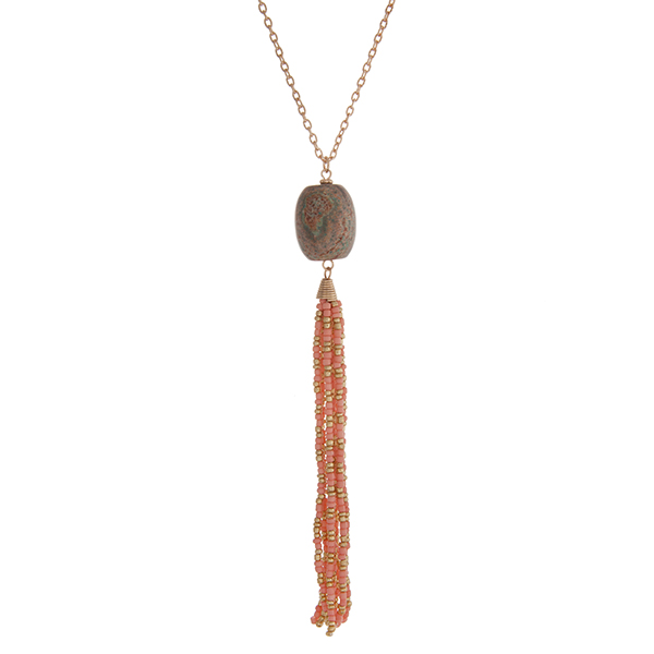 """Gold tone necklace with a natural stone bead and a pink seed bead tassel. Approximately 36"""" in length."""